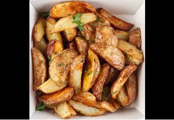 Дольки запеченого картофеля
